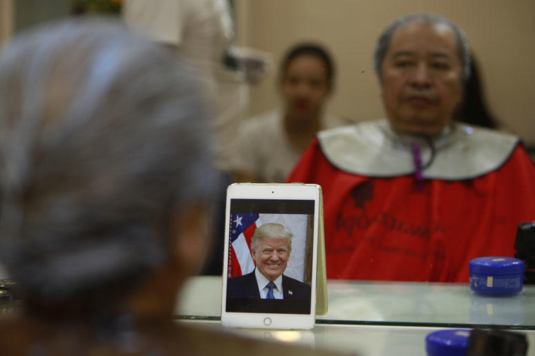 e Phuc Hai, 66, receives a Trump haircut in Hanoi, Vietnam, on Tuesday, Feb. 19, 2019. U.S. President Donald Trump and North Korean leader Kim Jong Un have become the latest style icons in Hanoi, a week before their second summit is to be held in the capi