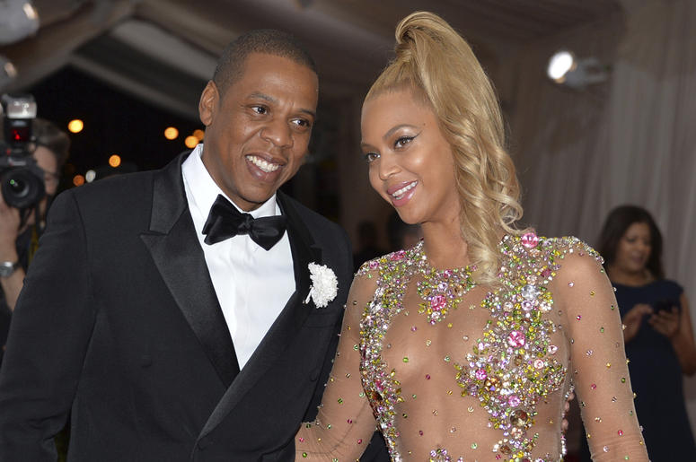 """In this May 4, 2015, file photo, Jay Z, left, and Beyonce arrive at The Metropolitan Museum of Art's Costume Institute benefit gala celebrating """"China: Through the Looking Glass"""" in New York. After bad weather forced concertgoers at the MetLife Stadium in"""