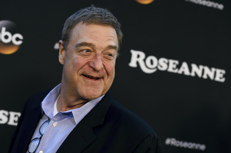"""In this March 23, 2018 file photo, John Goodman arrives at the Los Angeles premiere of """"Roseanne"""" in Burbank, Calif. Goodman is speculating that this fall's """"Roseanne"""" spinoff will mean curtains for the matriarch played by Roseanne Barr. In an interview w"""