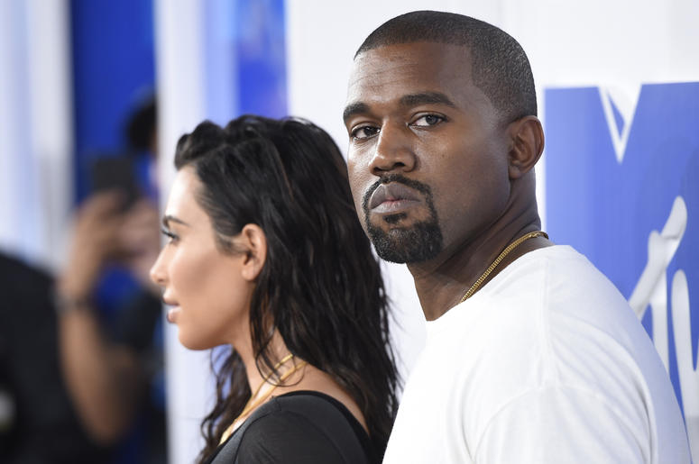 """In this Aug. 28, 2016 file photo, Kim Kardashian West, left, and Kanye West arrive at the MTV Video Music Awards in New York. Kanye West has apologized on a Chicago radio station for suggesting slavery was a """"choice."""" (Photo by Evan Agostini/Invision/AP,"""