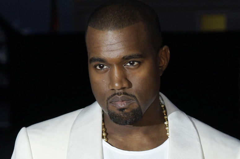 """In this May 23, 2012 file photo, singer Kanye West arrives for the screening of """"Cruel Summer"""" at the 65th international film festival, in Cannes, southern France. Kanye West will visit the White House on Thursday to meet with President Donald Trump and h"""