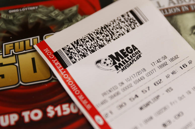A Mega Millions lottery ticket rests on the shop counter at the Street Corner Market, Wednesday, Oct. 17, 2018, in Cincinnati. The estimated jackpot for Friday's drawing would be the second-largest lottery prize in U.S. history with a jackpot estimated to