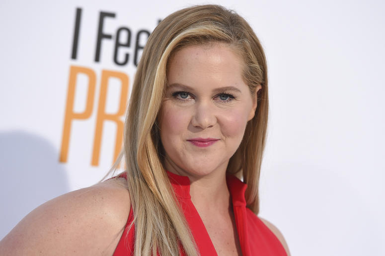"""In this April 17, 2018 file photo, Amy Schumer arrives at the world premiere of """"I Feel Pretty"""" at the Westwood Village Theater in Los Angeles. Schumer says don't look for her in a Super Bowl commercial this time around. She's sitting this one out in supp"""