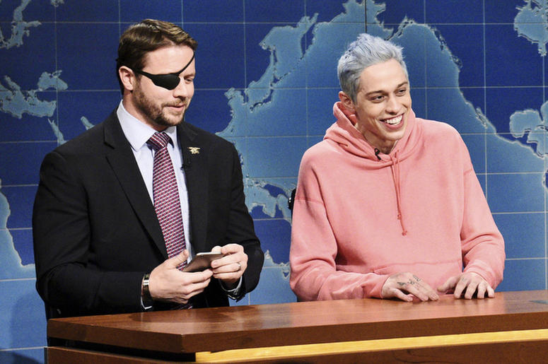 """In this Nov. 10, 2018 photo provided by NBC, Lt. Com. Dan Crenshaw, from left, a congressman-elect from Texas and Pete Davidson appear during Saturday Night Live's """"Weekend Update"""" in New York. Davidson made his apologies to Crenshaw whose appearance he m"""