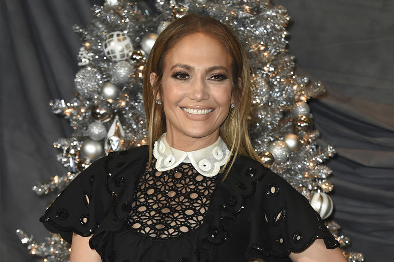"""In this Dec. 9, 2018 file photo, Jennifer Lopez attends a photocall for """"Second Act"""" at the Four Seasons in Los Angeles. In the film, in theaters nationwide Friday, her business savvy character gets a shot to prove herself to Madison Avenue's elite thanks"""