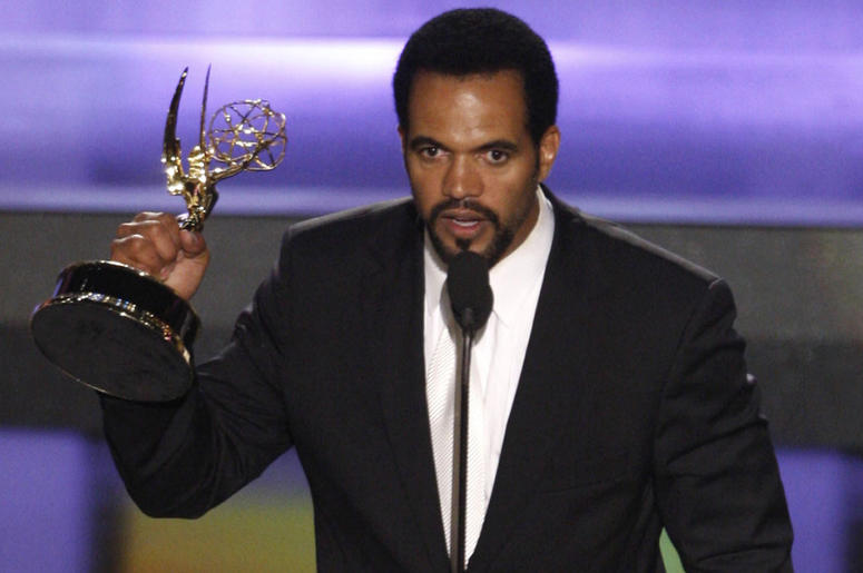 """In this June 20, 2008, file photo Kristoff St. John accepts the award for outstanding supporting actor in a drama series for his work on """"The Young and the Restless"""" at the 35th Annual Daytime Emmy Awards in Los Angeles. John has died at age 52. Los Angel"""