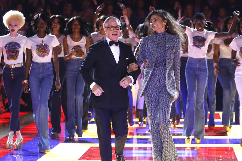 Designer Tommy Hilfiger, left, and actress Zendaya walk the runway with models at the conclusion of the Tommy Now ready to wear Fall-Winter 2019-2020 collection, that was presented in Paris, Saturday, March 2, 2019. (AP Photo/Michel Euler)