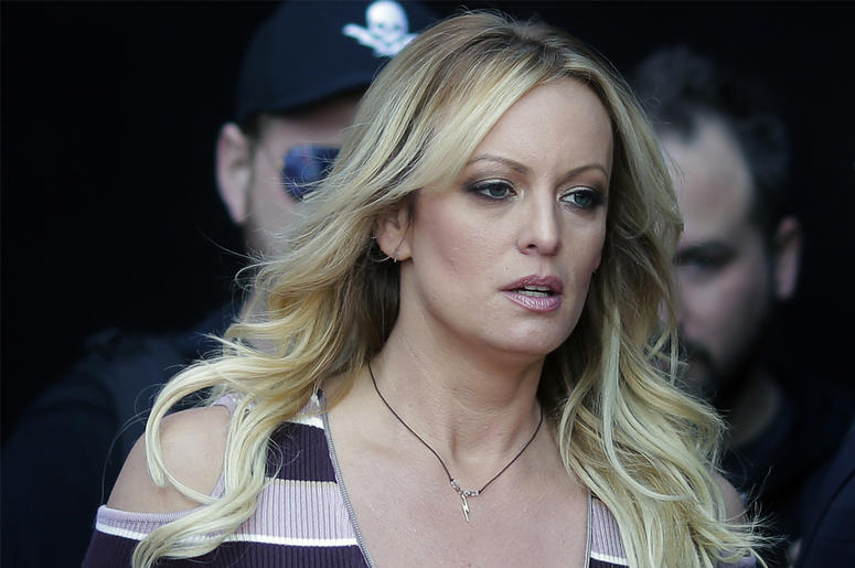 """In this Oct. 11, 2018, file photo, adult film actress Stormy Daniels arrives at the adult entertainment fair """"Venus"""" in Berlin. (AP Photo/Markus Schreiber, File)"""