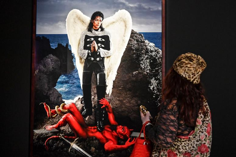 A visitor watches the picture 'Archangel Michael: And no message could have been any clearer' from US artist David LaChapelle at a preview of the exhibition 'Michael Jackson: On The Wall' at the Bundeskunsthalle museum in Bonn, Germany, Thursday, March 21