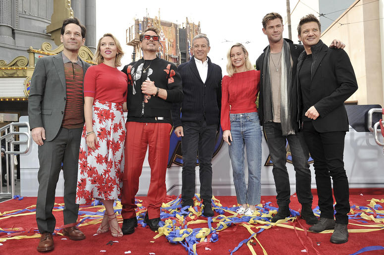 """Avengers: Endgame"" cast members, Paul Rudd, from left, Scarlett Johansson, Robert Downey Jr., Robert Iger, Brie Larson, Chris Hemsworth and Jeremy Renner appear at an event announcing the Universe Unites Charity at Disney California Adventure Park on Fri"