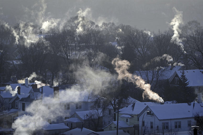 In this Wednesday Jan. 30, 2019, file photo smoke rises from the chimneys of homes in St. Paul, Minnesota (Brian Peterson/Star Tribune via AP, File)