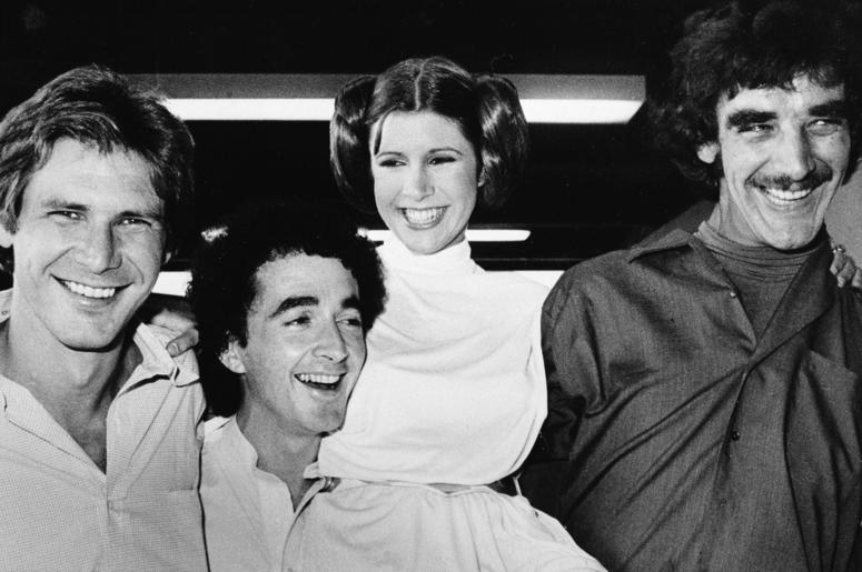 """In this Oct. 5, 1978 file photo, actors featured in the """"Star Wars"""" movie, from left, Harrison Ford who played Han Solo, Anthony Daniels who played the robot C3P0, Carrie Fisher who played the princess, and Peter Mayhew who played the Wookie, Chewbacca, a"""