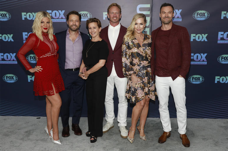 """Tori Spelling, from left, Jason Priestley, Gabrielle Carteris, Ian Ziering, Jennie Garth and Brian Austin Green, from the cast of """"BH90210,"""" attend the FOX 2019 Upfront party at Wollman Rink in Central Park on Monday, May 13, 2019, in New York. (Photo by"""