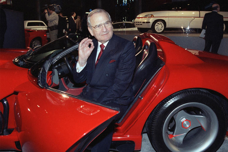 In this March 28, 1990, file photo, Chrysler Corporation Chairman Lee Iacocca sits in a 1990 Dodge Viper sports car as the Chrysler in the 90's six city tour makes a visit to New York. (AP Photo/Osamu Honda, File)