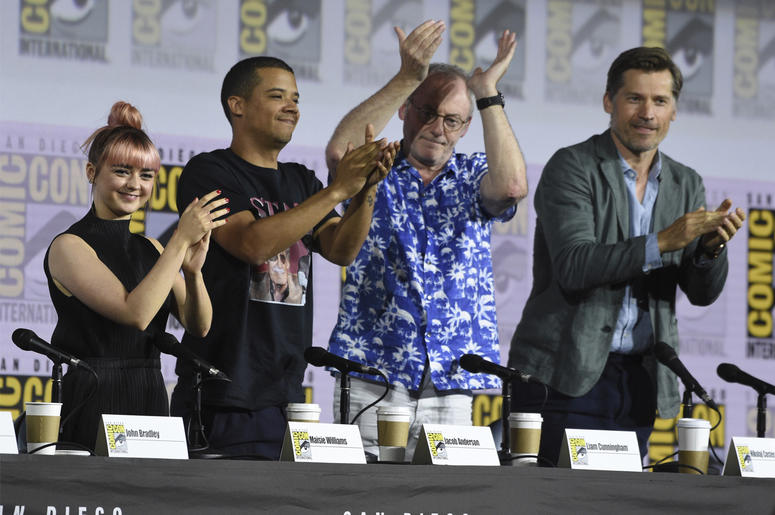 """Maisie Williams, from left, Jacob Anderson, Liam Cunningham and Nikolaj Coster-Waldau clap at the conclusion of the """"Game of Thrones"""" panel on day two of Comic-Con International on Friday, July 19, 2019, in San Diego. (Photo by Chris Pizzello/Invision/AP)"""
