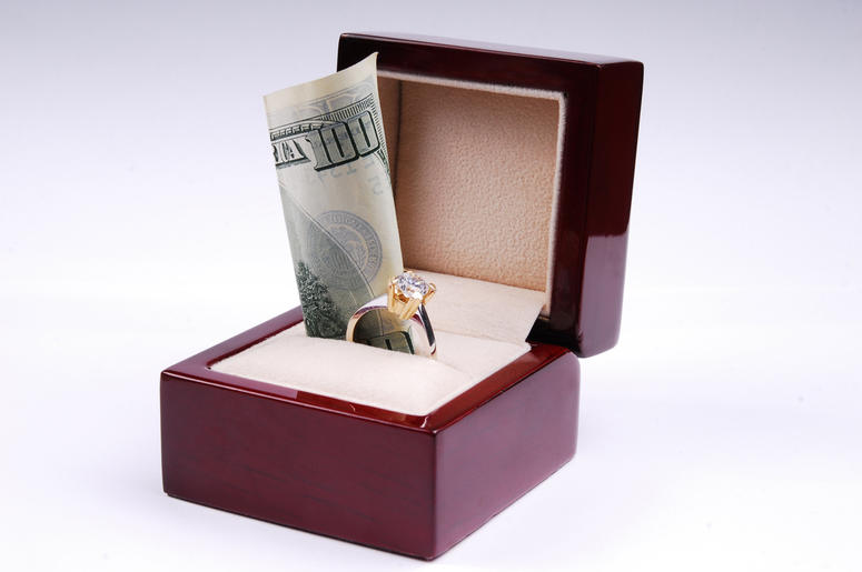 Wedding Ring & Cash (Photo credit: Getty Images)