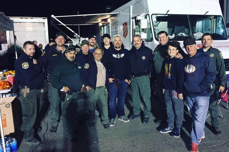 Guy Fieri made a surprise visit to serve dinner to everyone at the law enforcement staging area at Butte College. Thank you so much Guy for filling our bellies and lifting our spirits.  #ButteSheriff #CampFire (Photo credit: Butte County Sheriff)