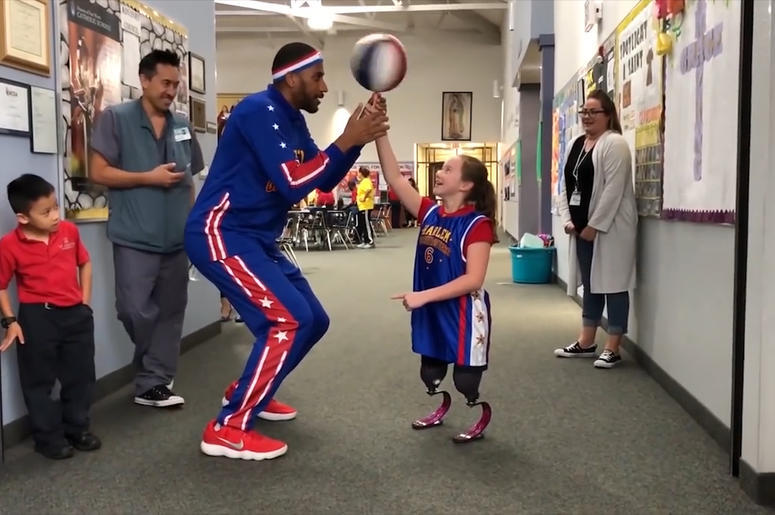 Harlem Globetrotters' Zeus McClurkin and Lilly Biagini (Photo credit: Radio.com)