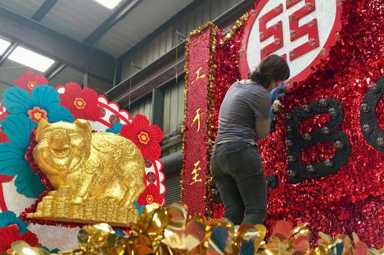Floats for the Chinese New Year parade in San Francisco are under construction in a waterfront warehouse on Feb. 19, 2019. (Photo credit: Jenna Lane/KCBS Radio)