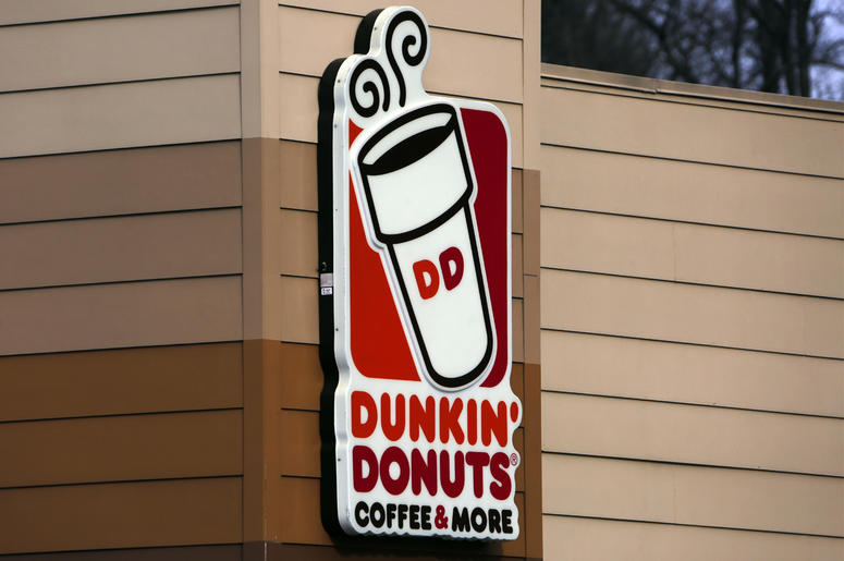 """This Jan. 22, 2018, file photo shows the Dunkin' Donuts logo on a shop in Mount Lebanon, Pa. First, Dunkin' dropped the """"Donuts"""" from its name. Now, it's adding espresso drinks to its menu. Dunkin' says most of its 9,200 U.S. stores will offer lattes, cap"""