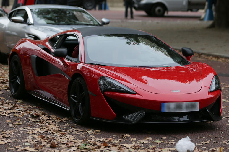 9/24/2016 - A McLaren (front in red) sports car during filming of the film Transformers: The Last Knight, on The Mall in London. (Photo by PA Images/Sipa USA)