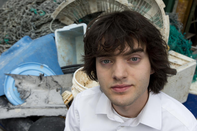 In this May 11, 2017, file photo, Dutch innovator Boyan Slat poses for a portrait next to a pile of plastic garbage prior to a press conference in Utrecht, Netherlands. Engineers will deploy a trash collection device to corral plastic litter floating betw