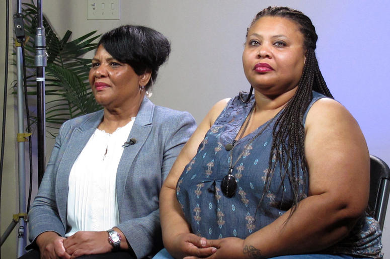 In this June 7, 2018 file photo, Alice Marie Johnson, left, and her daughter Katina Marie Scales wait to start a TV interview on in Memphis, Tenn. Johnson, an inmate whose life sentence was commuted thanks in part to the efforts of Kim Kardashian West, no