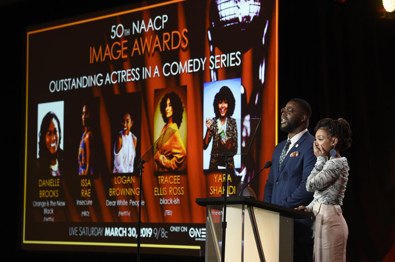 Logan Browning, right, reacts as Winston Duke announces her as a nominee for the 50th annual NAACP Image Awards during TV One's Winter Television Critics Association Press Tour on Wednesday, Feb. 13, 2019, in Pasadena, Calif. (Photo by Chris Pizzello/Invi