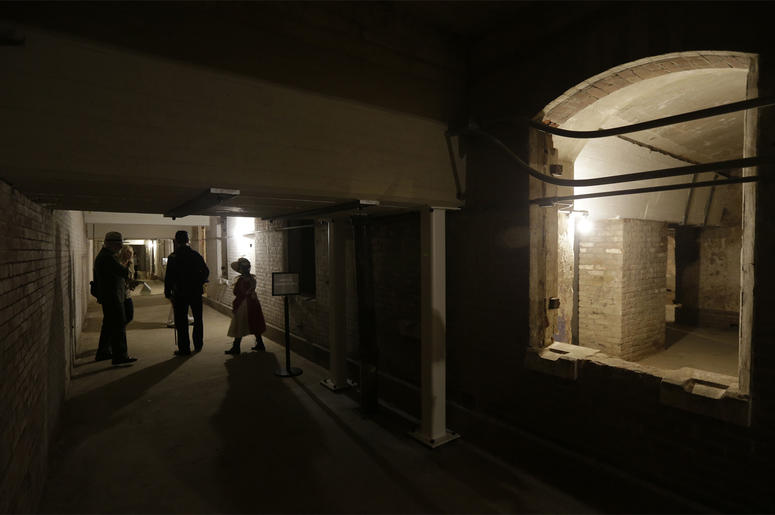 In this July 1, 2015 file photo, people walk through the citadel, also known as the the dungeon, during a tour of newly restored areas on Alcatraz Island in San Francisco. (AP Photo/Eric Risberg)