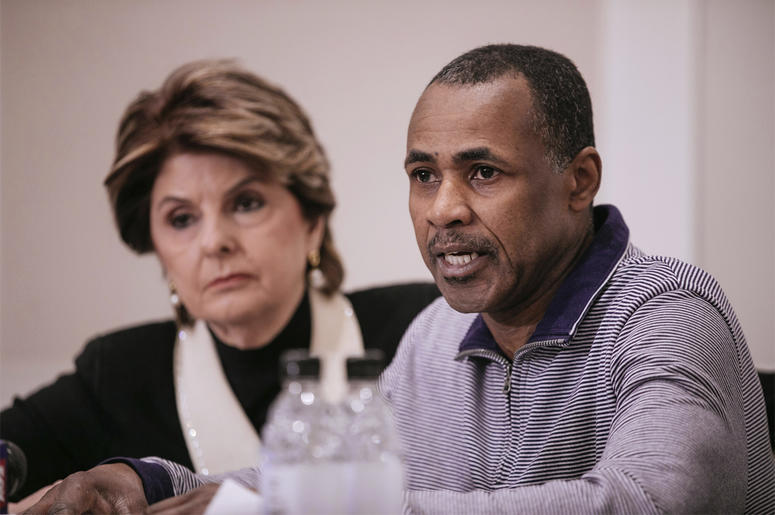 Gary Dennis, seated with Lawyer Gloria Allred, speaks during a press conference announcing a video tape said to present further evidence of wrongdoing by recording artist R. Kelly Sunday, March 10, 2019, in New York. (AP Photo/Kevin Hagen)