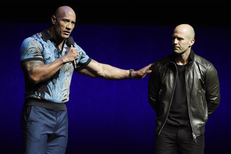 """Dwayne Johnson, left, and Jason Statham, cast members in the upcoming film """"Fast and Furious Presents: Hobbs & Shaw,"""" appear during the Universal Pictures presentation at CinemaCon 2019, the official convention of the National Association of Theatre Owner"""