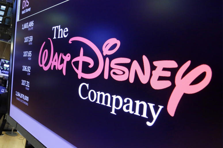 In this Aug. 8, 2017, file photo, The Walt Disney Co. logo appears on a screen above the floor of the New York Stock Exchange.