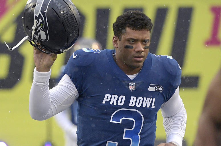 In this Jan. 27, 2019, file photo, NFC quarterback Russell Wilson of the Seattle Seahawks runs onto the field during player introductions before the NFL Pro Bowl football game against the AFC in Orlando, Florida. (AP Photo/Phelan M. Ebenhack, File)