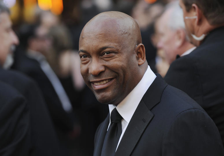 In this Feb. 24, 2008 file photo, director John Singleton arrives at the 80th Academy Awards in Los Angeles. Oscar-nominated filmmaker John Singleton has died at 51, according to statement from his family, Monday, April 29, 2019. He died Monday after suff