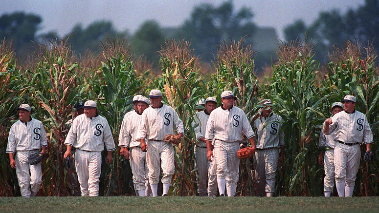 """In this July 22, 1977, file photo, people portraying ghost players emerge from a cornfield as they reenact a scene from the movie """"Field of Dreams"""" at the movie site in Dyersville, Iowa. The Chicago White Sox will play a game against the New York Yankees"""