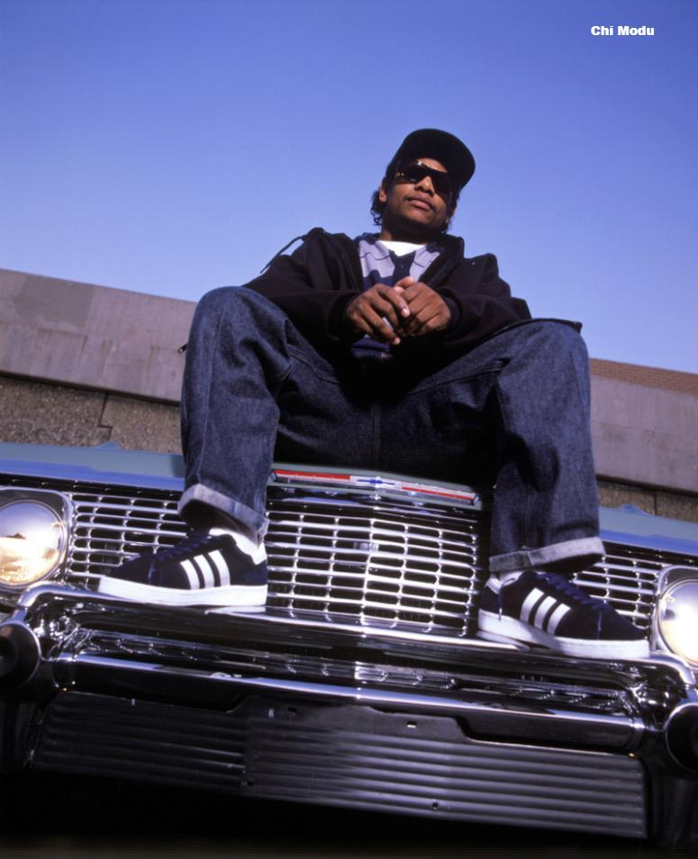 Eazy E (Eric Wight) sitting on the hood of his car in Compton, CA in 1994, one year before his untimely death. This photo is from the Defining Years of Hip-Hop 1990-2000 (Photo by Chi Modu/diverseimages)