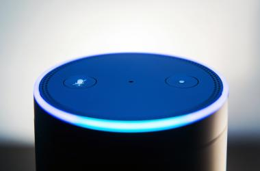 Amazon echo voice recognition system, selective focus and dark backdrop for impact of light ring