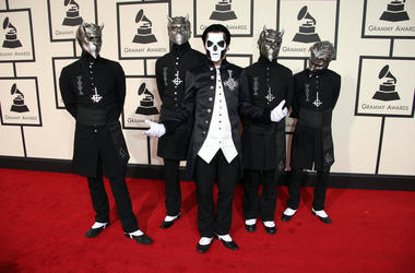 Members of the band Ghost arrive on the red carpet during the 58th Grammy Awards