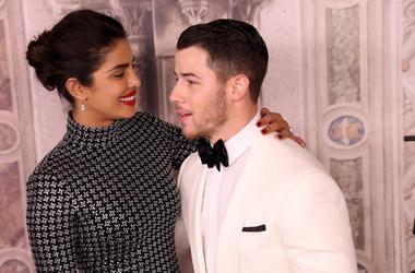 Priyanka Chopra and Nick Jonas attend the Ralph Lauren fashion show during New York Fashion Week