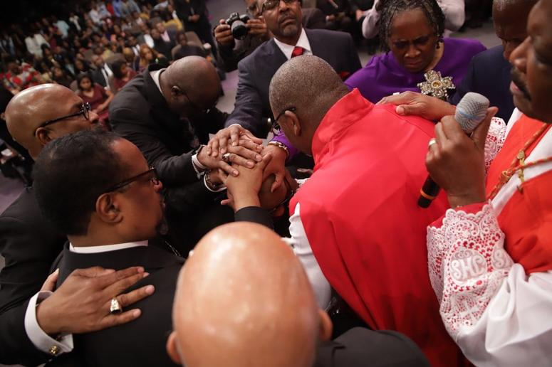 "Faith leaders participating in the ""Laying of Hands"" during the Installation Service for Dr. Jamal Bryant"