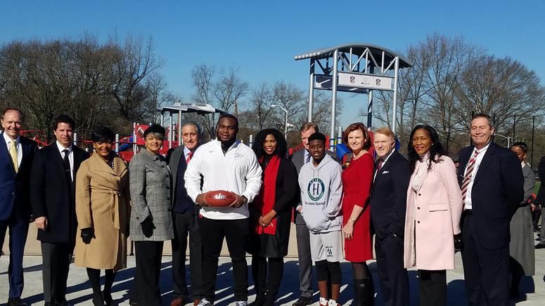 Shalise Steele Young (4th from left), widow of Atlanta City Council Ivory Young joined in the celebration of the J.F. Kennedy Park Improvement Project