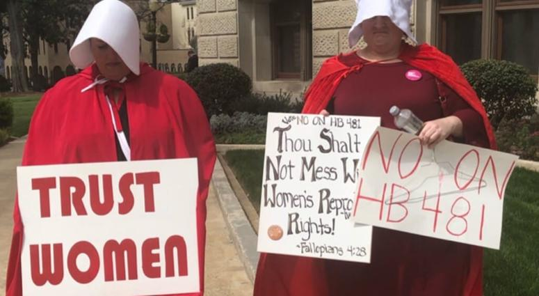 "Dressed as characters from the fictional tv show and book ""The Handmaids Tail"" (about a totalitarian society) protestors have been assembling at the GA Capitol"