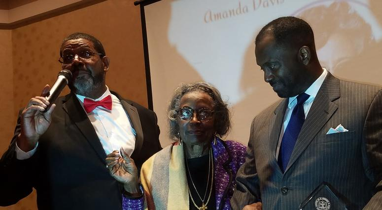 Mrs. Juanita Abernathy is flanked by Fulton County Commissioner Michael Lankford and her son Kwame Abernathy during a recent awards ceremony