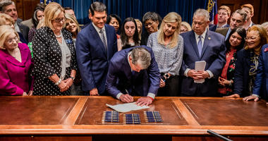 Georgia Governor Brian Kemp signs bill banning abortions after 6 weeks.