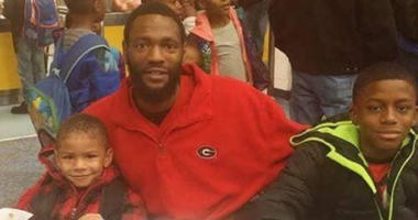 "Autopsy indicates that 32 year old Antonio May (shown with 2 of his 3 sons) died of ""excessive force"" inside the Fulton County jail on September 11, 2018"