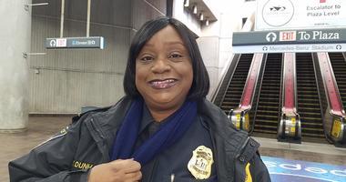 MARTA Chief Wanda Dunham proudly shows special Super Bowl LIII badge