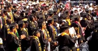 The Morehouse Class of 2019 stands after hearing that their student debt is being paid in full.