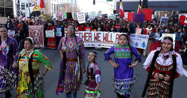Native Americans lead the march down Virginia Street as thousands take part in the Women's March in Reno.