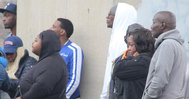 Rapper Young Thug (white hoodie) is spotted at the scene of a double deadly shooting in southwest Atlanta