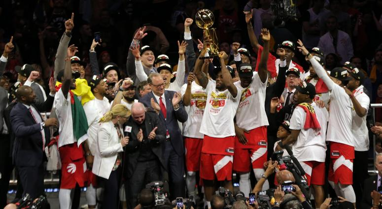 Jun 13, 2019; Oakland, CA, USA; Toronto Raptors forward Kawhi Leonard (2) lifts up the Larry O'Brien Championship Trophy after defeating Golden State Warriors for the NBA Championship in game six of the 2019 NBA Finals